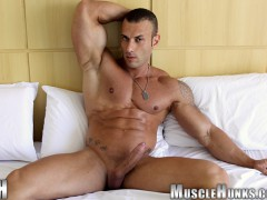 Sicilian big muscle bodybuilder Gianluigi Volti strips naked and jerks his huge muscle cock