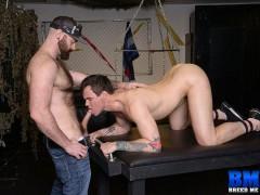 Beau Reed gets on his knees to service Luke Harrington's huge cock