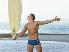 Gay pornstar Brady Jensen turns his hand to surfing