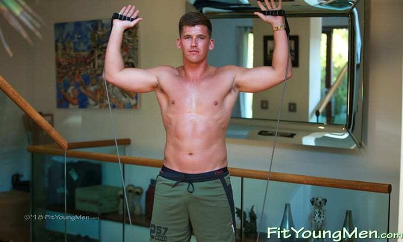 Hot fit young sports dude Henry Thompson strips down to his sexy undies