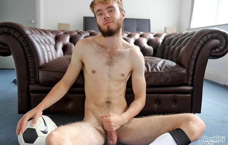 21 year old Tom Jackson strips out of his soccer kit and jerks his thick fat uncut cock to a massive load of hot boy cum