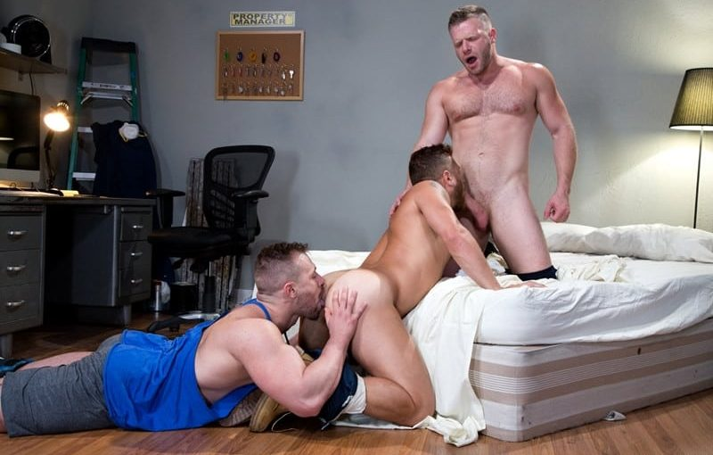 With Blake Hunter's cock down Riley Mitchell's throat Brian Bonds slides his shaft deep into Riley's crack to spit-roast the tatted hunk