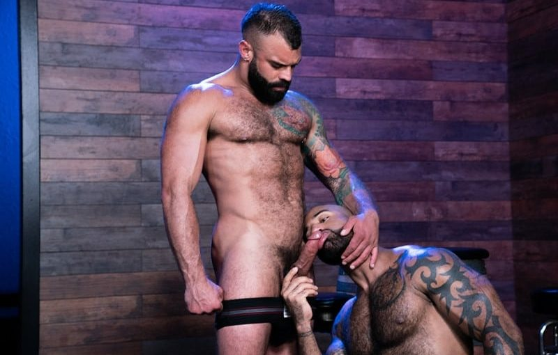 Daymin Voss can't resist touching Drake Masters' rock-hard hairy body reaching down to grope his massive cock bulge