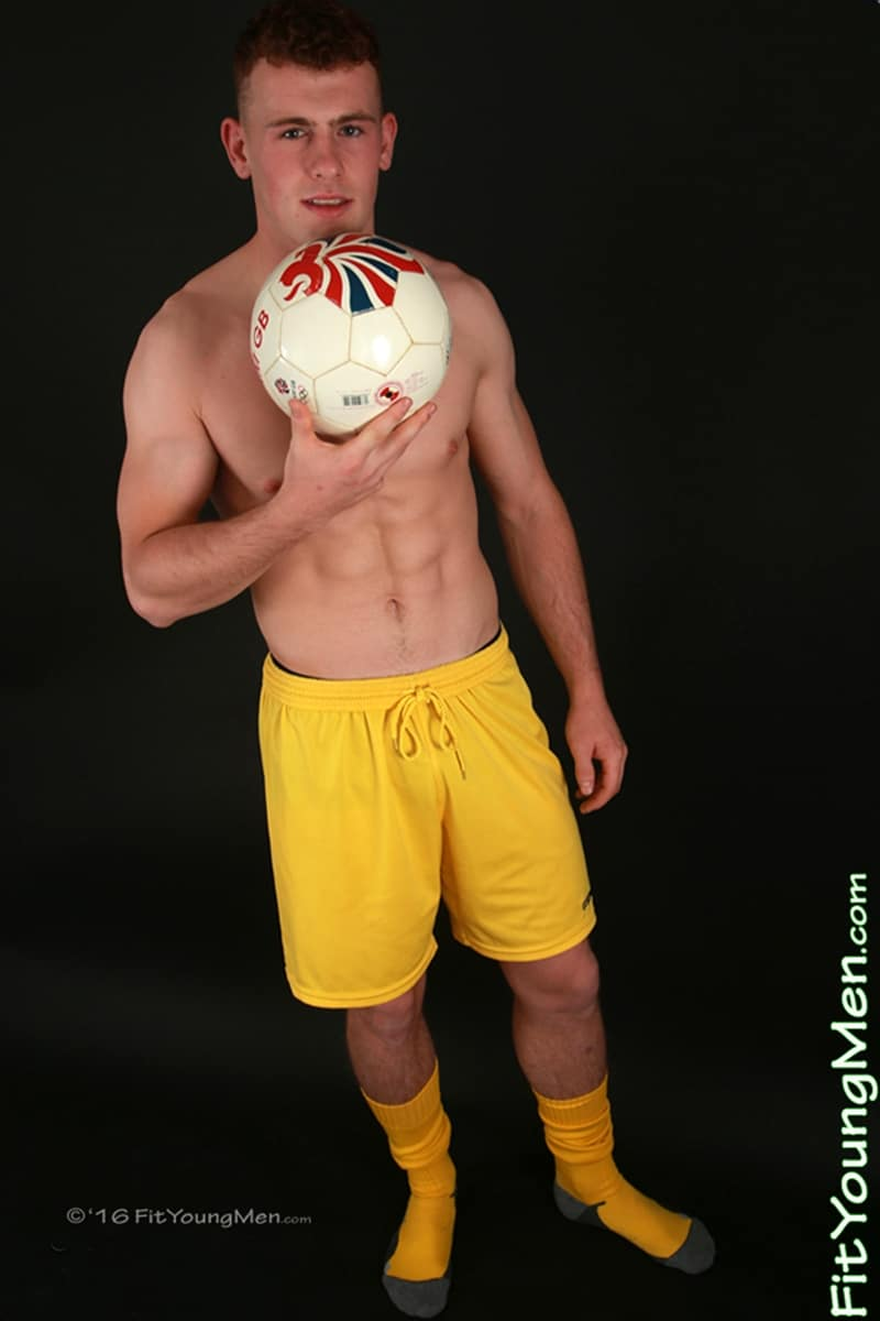 Ripped-young-muscle-stud-Tom-Stevens-strips-football-kit-wanking-big-uncut-dick-FitYoungMen-006-Gay-Porn-Pics